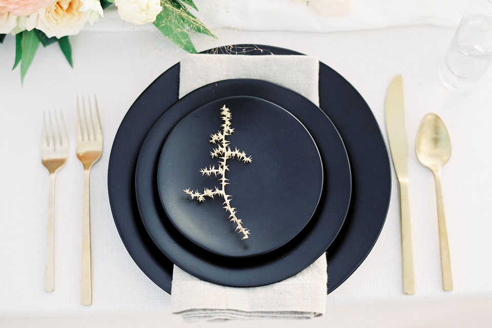Desert-Lux-Shoot-flatware-in-black-matte-style-with-gold-cutlery-and-white-linens