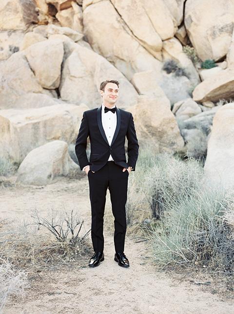 Desert-Lux-Shoot-groom-in-a-black-tuxedo