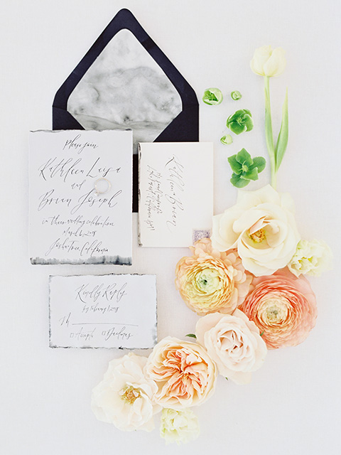 Desert-Lux-Shoot-invitations-with-white-paper-and-black-envelopes