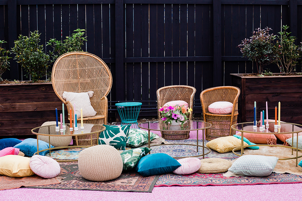 outdoor bohemian furniture with multicolored pillows everywhere