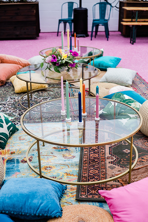outdoor coffee table furniture with multicolored tall candles on it