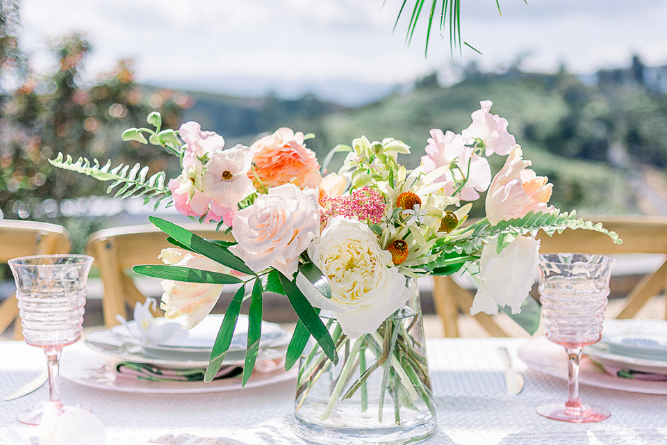 emerald-peak-temecula-wedding-florals-on-table-in-bright-tropical-colors