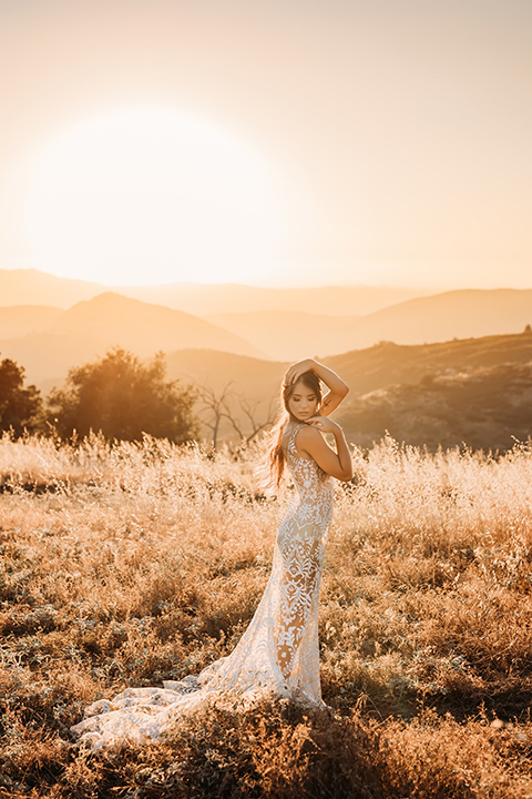 bride in a white bohemian style lace gown with a straps and a her hair in loose waves