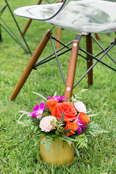 Ole-Hanson-Beach-Club-ceremony-décor-with-bright-florals-and-mid-century-style-chairs
