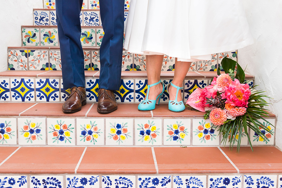 Ole-Hanson-Beach-Club-close-up-on-couples-foot-wear-the-groom-in-a-blue-suit-with-brown-shoes-and-the-bride-is-wearing-a-teal-heel-with-a-tea-length-gown