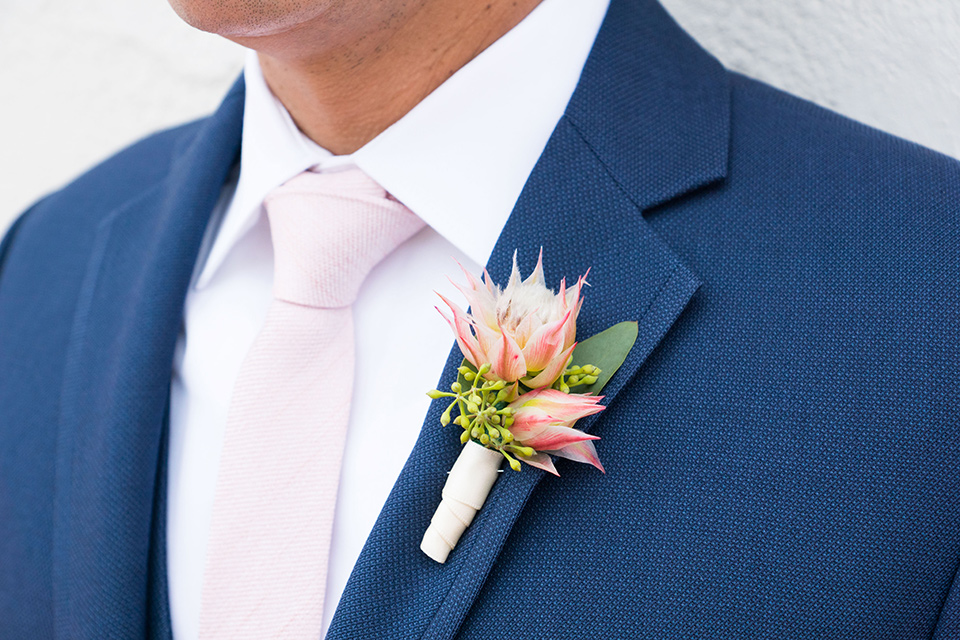 Ole-Hanson-Beach-Club-close-up-on-groom-attire-in-a-dark-navy-blue-suit-with-a-blush-pink-long-tie-and-brown-shoes