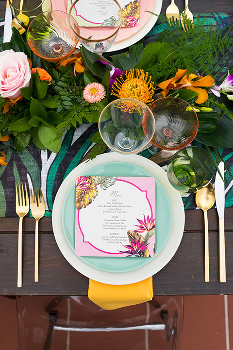 Ole-Hanson-Beach-Club-flatware-with-gold-flatware-and-colorful-plates-and-linens-in-teal-orange-and-pink