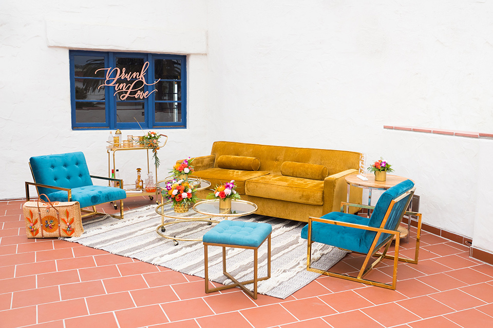 Ole-Hanson-Beach-Club-reception-décor-with-mustard-and-teal-furniture-and-trendy-rungs