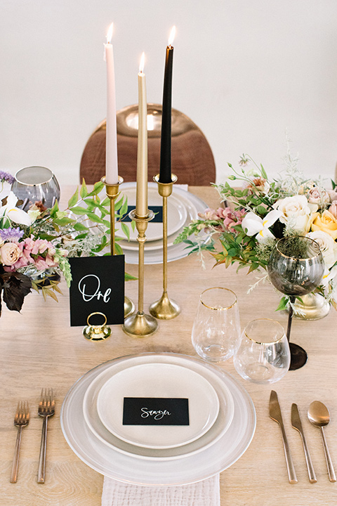 Modern-Mystical-Styled-shoot-at-the-york-table-décor-with-tall-candles-and-white-plates