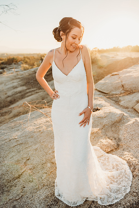 Moonflower-Ranch-Shoot-bride-alone-lace-form-fitting-gown-with-straps-and-v-neck-line