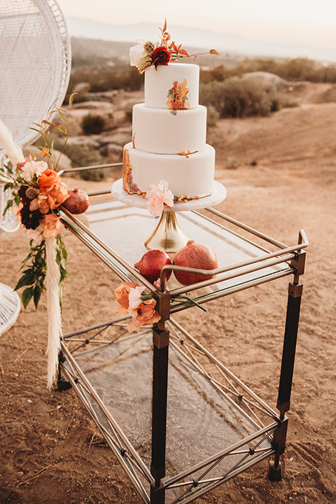 Moonflower-Ranch-Shoot-cake-with-white-fondant-and-orange-flower-decor