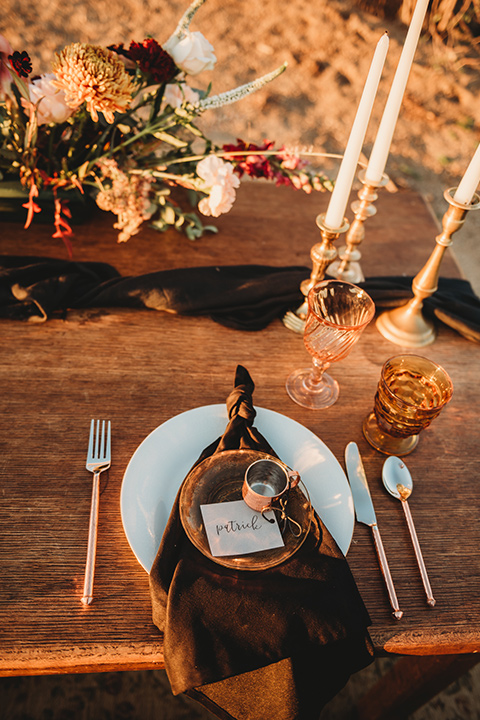 Moonflower-Ranch-Shoot-table-décor-with-gold-décor-and-white-tall-candles