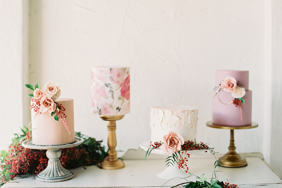 II-Mercato-in-New-Orleans-cakes-on-tables-one-tiered-cake-with-astel-colored-and-hand-painted-flowers