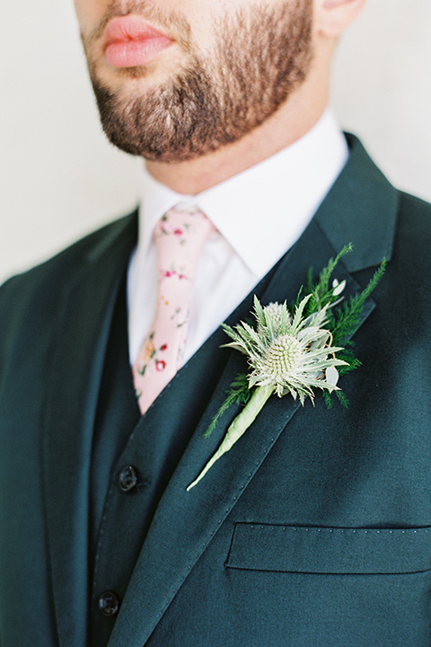 II-Mercato-in-New-Orleans-close-up-on-groom-attire-groom-in-a-green-suit-with-brown-shoes-and-floral-long-tie