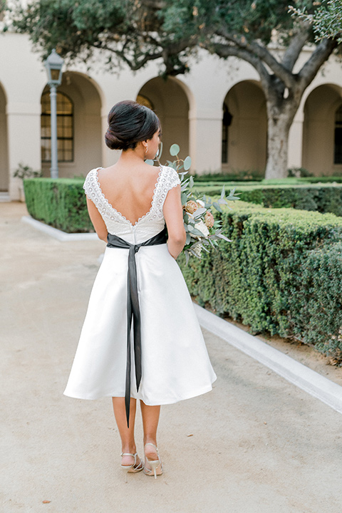 Pasadena-city-hall-styled-shoot-back-of-short-teal-length-bridal-gown-with-cap-sleeves