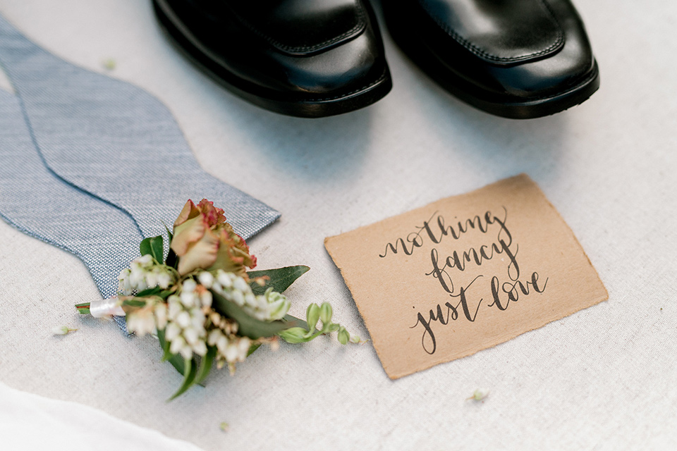 Pasadena-city-hall-styled-shoot-groom-accessories-with-a-light-blue-bow-tie-and-black-dress-shoes