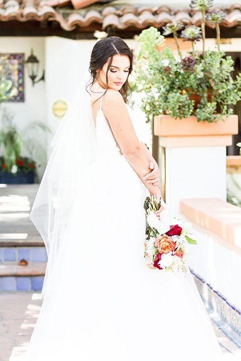 rancho-las-lomas-spring-shoot-bride-alone-in-an-a-line-dress-with-a-plunging-neckline-and-hair-up-in-a-loose-bun