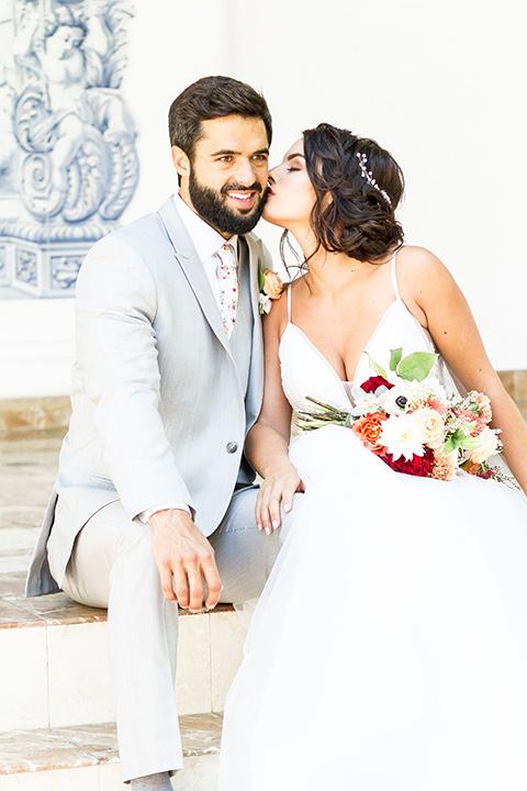 rancho-las-lomas-spring-shoot-bride-and-groom-sitting-on-steps