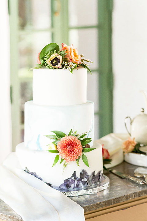 rancho-las-lomas-spring-shoot-cake-with-white-fondant-and-orange-flower-decor