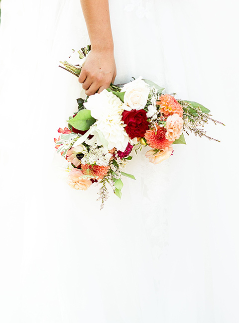 rancho-las-lomas-spring-shoot-florals-in-bright-sunny-florals-with-reds-oranges-and-greens