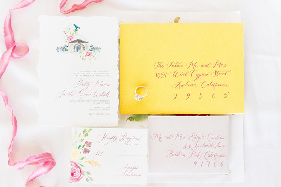 rancho-las-lomas-spring-shoot-invitations-on-white-and-pink-pastel-paper-with-yellow-invitations-and-cursive