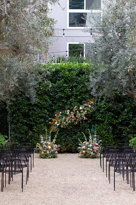 ceremony florals and black metal chairs