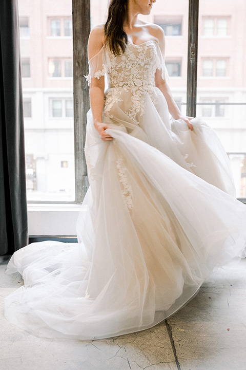 Romatic-Wedding-at-the-ACE-bridal-gown-in-a-blush-toned-tulle-gown-with-a-sweetheart-neckline-and-an-off-the-shoulder-detail