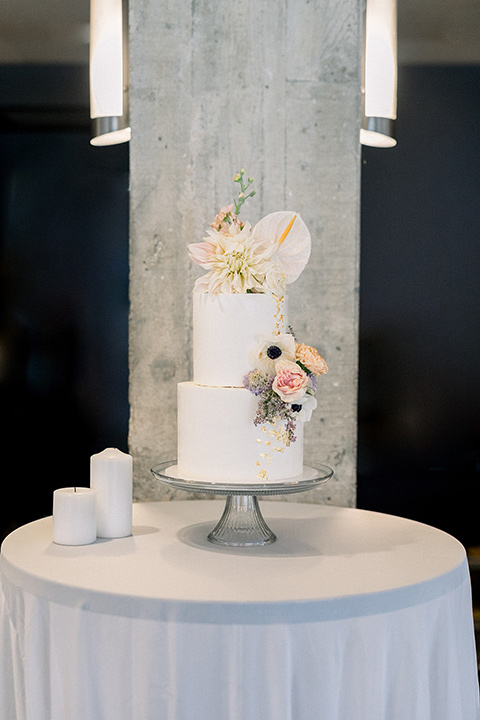 Romantic-Wedding-at-the-ACE-two-tiered-cake-with-white-fondant-and-lillies-as-the-flower-decor