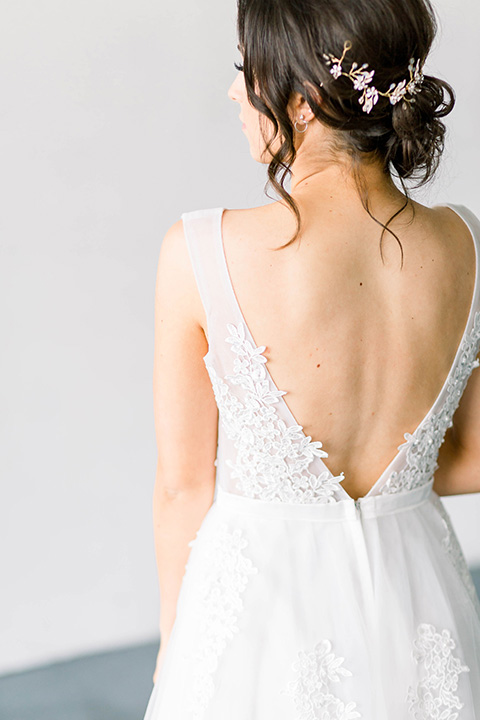 Spring-styled-shoot-bridal-gown-with-a-open-back-and-lace-cap-sleeves-and-soft-tulle-skirt
