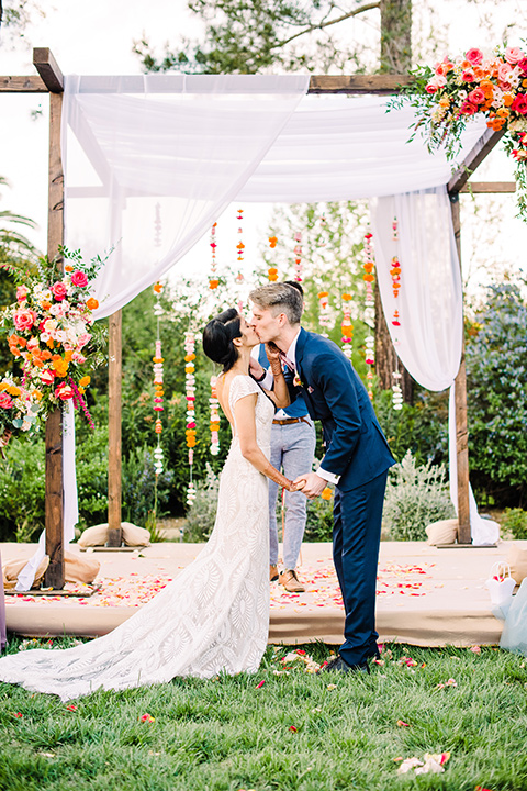 Supriya-and-Chris-wedding-bride-and-groom-first-kiss