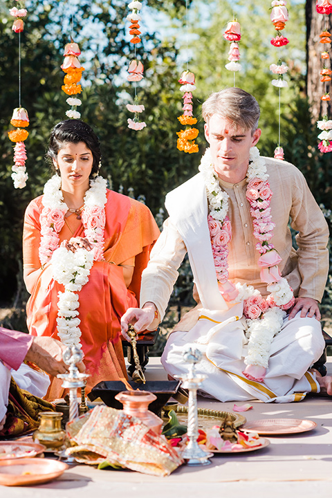 Supriya-and-Chris-wedding-bride-and-groom-sitting-at-indian-ceremony