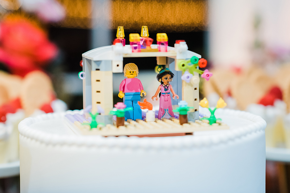 Supriya-and-Chris-wedding-cake-with-lego-topper