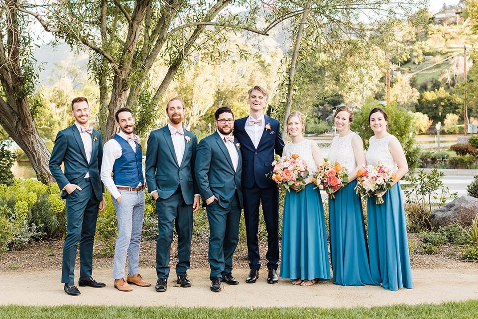 Supriya-and-Chris-wedding-grooms-bridal-party-the-groomsmen-in-blue-suit-and-the-groomswomen-are-in-blue-and-cream-gowns