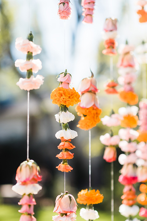 Supriya-and-Chris-wedding-hanging-flowers-on-ceremony-arch