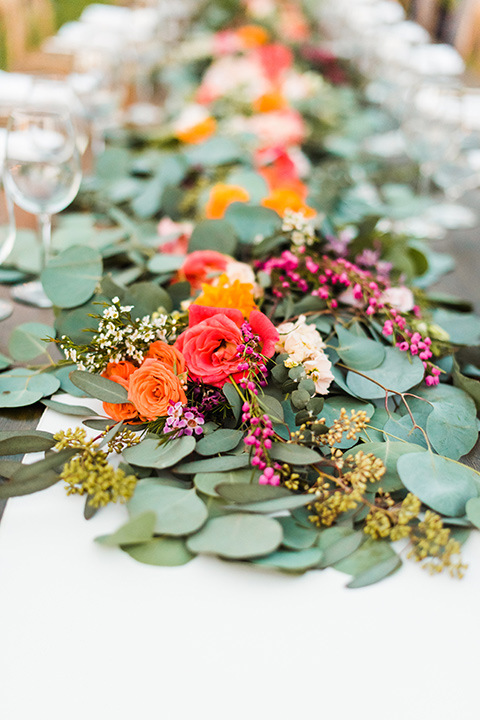 Supriya-and-Chris-wedding-table-centerpiece-with-sage-and-red-and-orange-flowers
