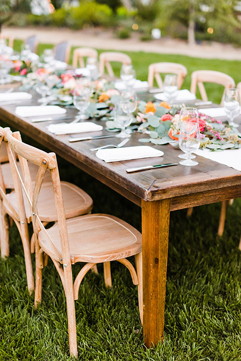 Supriya-and-Chris-wedding-table-décor-with-wooden-tables-and-chairs