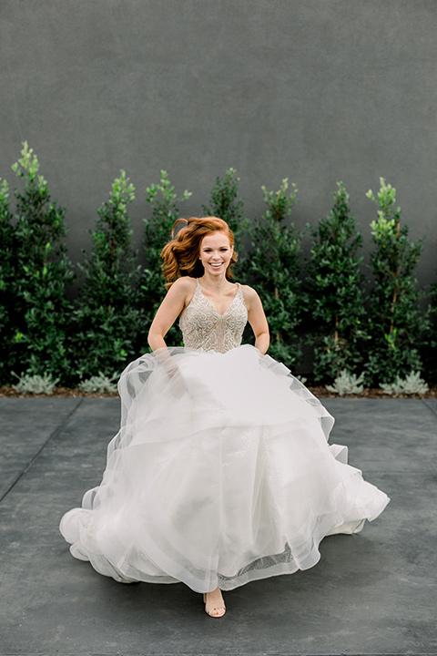 The-Harper-Shoot-bride-running-in-her-tulle-ballgown-with-beaded-bodice