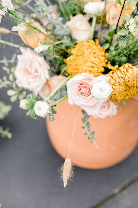 The-Harper-Shoot-ceremony-flowers-in-bright-oranges-and-yellows