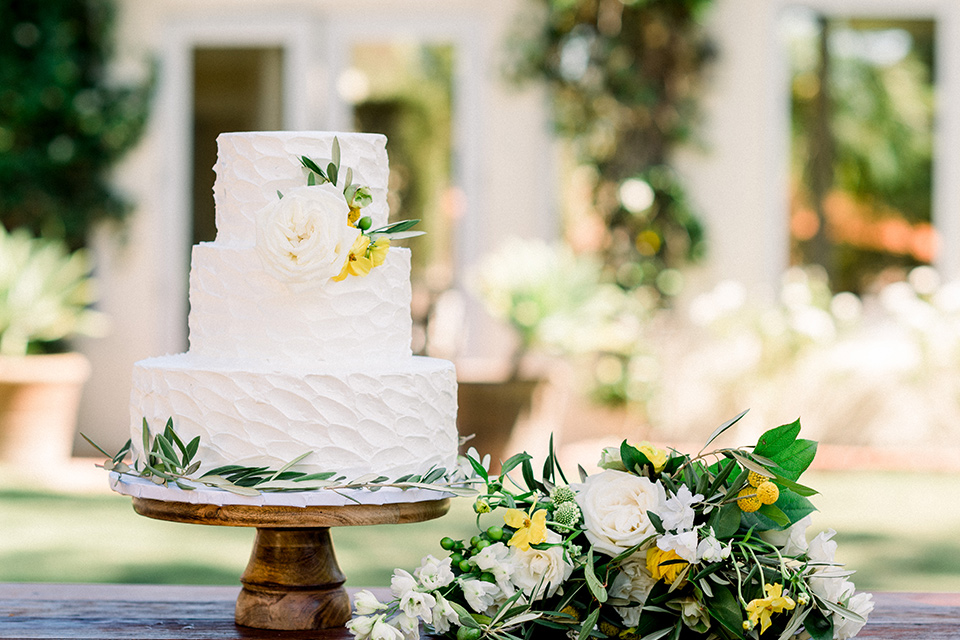 Inn-at-Rancho-Santa-Fe-wedding-cake-with-three-teirs-in-white-and-yellow-flowers