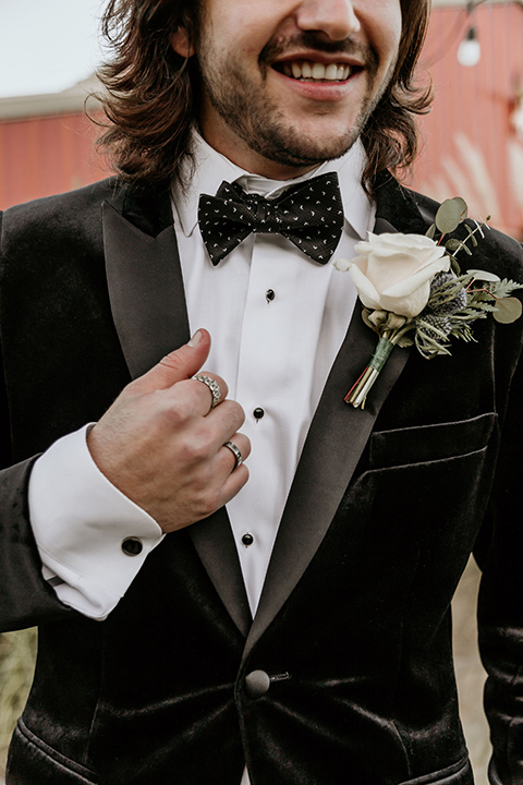 The-Retro-Ranch-Shoot-groom-attire-close-up-groom-in-a-black-velvet-coat-with-light-grey-pants