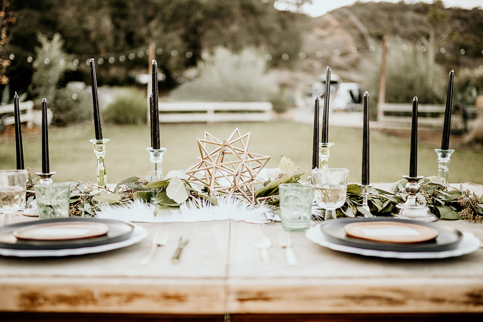 The-Retro-Ranch-Shoot-table-décor-with-tall-black-cendles-and-gold-accents