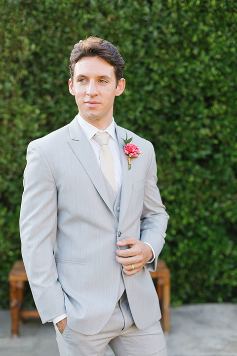 The-Ruby-Street-70s-Inspired-Shoot-close-up-on-groom-in-a-light-grey-suit-with-a-champagne-long-tie