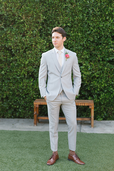 The-Ruby-Street-70s-Inspired-Shoot-groom-standing-in-a-light-grey-suit-with-a-champagne-long-tie