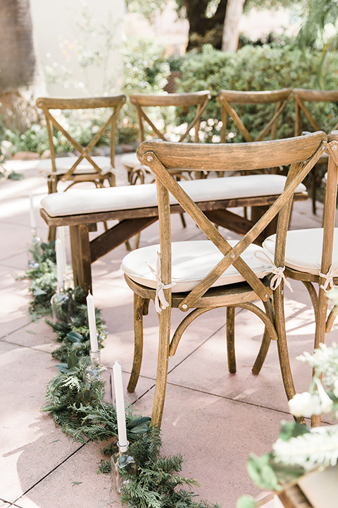 Maxwell-House-wood-chairs-with-greenery-and-white-cushions