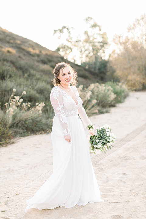 community-church-wedding-bride-smiling-at-camera-bride-in-a-flowing-boho-style-dress-with-sleeves