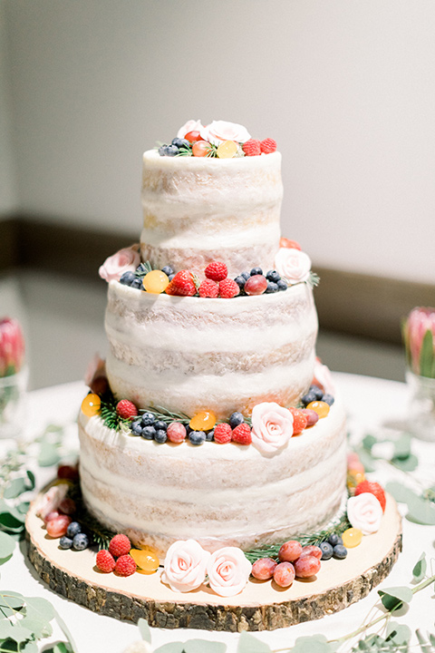 community-church-wedding-cake-with-white-fondant-and-fresh-berries