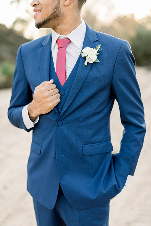 community-church-wedding-close-up-on-groom-groom-in-a-royal-blue-suit-with-berry-tie