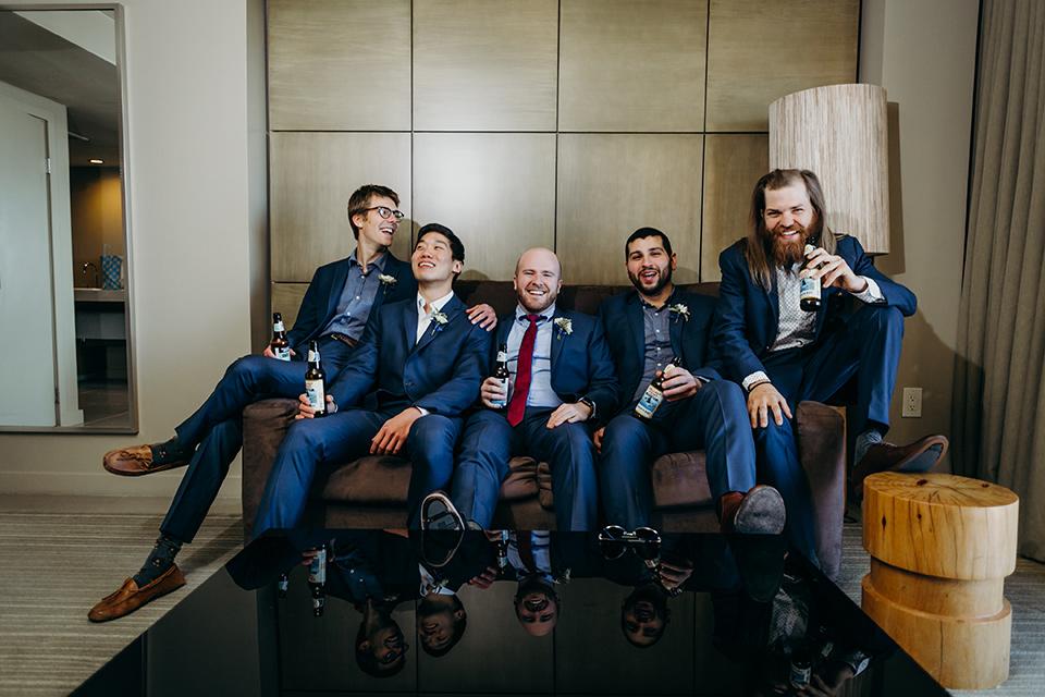 la-jolla-wedding-groomsmen-in-blue-suits-and-white-shirts-groom-in-blue-suit-with-a-blue-shirt