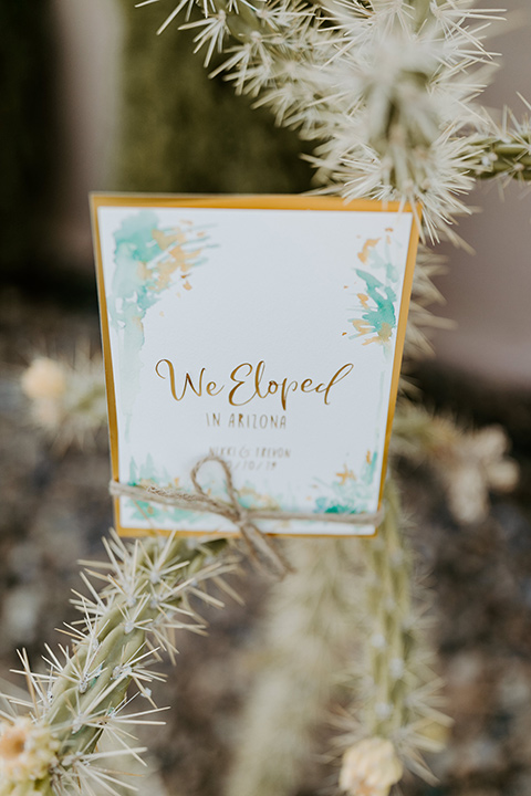 white invitations with gold lettering
