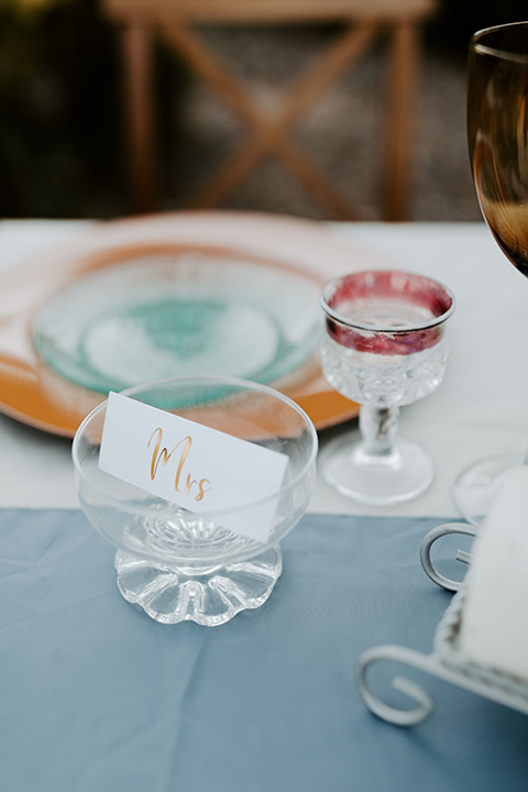 white and blue table décor wit orange and white décor and styling